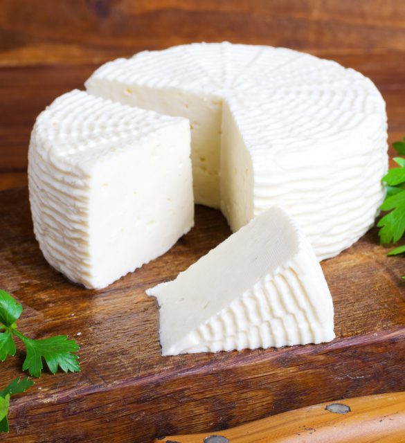 Soft salty cheese on a wooden table