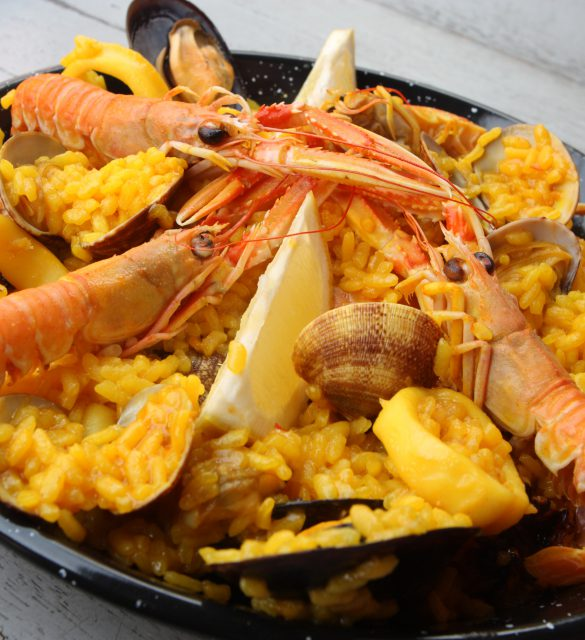 Spanish tradicional paella home-made composed of rice, and  fresh seafood like clams, king prawns and squid rings.