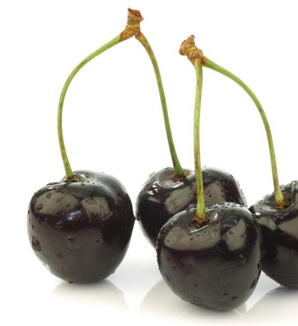 black sweet cherries on a white background