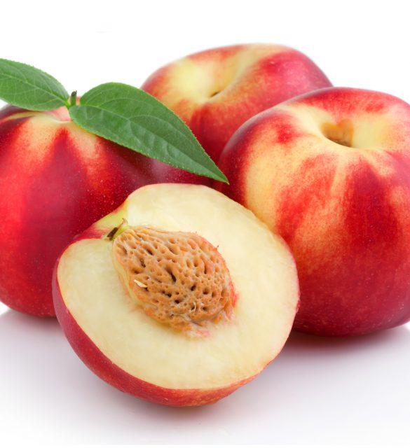 Three ripe peach (nectarine) fruits with slices isolated on white