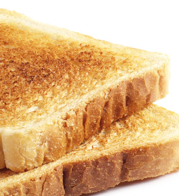 Two roasted toast bread on white background closeup