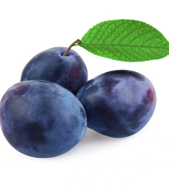 Plums with leaf isolated on white background