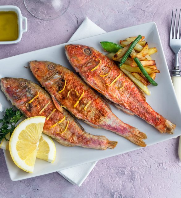 Fried Red Mullet or Turkish Barbunya on Plate, top view.