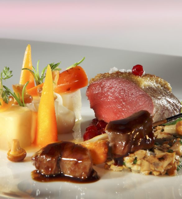 Saddle of venison on a bed of chanterelles with a side of vegetables
